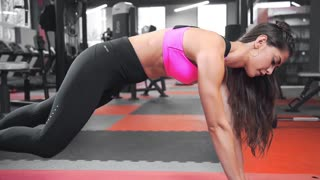Beautiful sexy woman in tight fitting sportswear stretches after training at the gym, perfect body and shape, fitness and workout, hot body, sports and exercises
