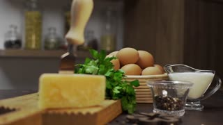 Cheese and eggs are on the kitchen table, ingredients for cooking omelette at home, ingredients for frittata, healthy natural food