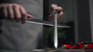 Chef sharpens the knife at the kitchen, preparations for food cooking, kitchen tools, cooking food, delicious recipes, food videos
