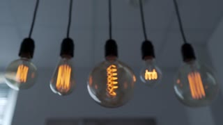 Edison lamp is glowing, electric bulb, turning the lights on, electric light, incandescent lamp, hot spiral of tungsten bulb