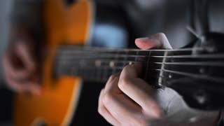 Guitar player plays random chords on the acoustic western guitar with steel strings ,exercises and arpeggios, video with sound, plaing the guitar, muscial instrument