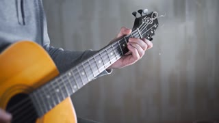 Guitarist plays on the acoustic western guitar with steel strings spanish random chords,exercises and arpeggios, video with sound, plaing the guitar, muscial instrument