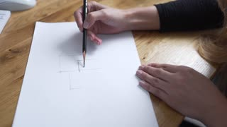 Painter draws by pencil and drawings become reality, designer draws the draught, woman draws lines, architect begins to draw the project on paper
