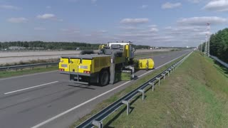 Road machinery for cleaning roads and highways from snow and dirt, big truck cleans the road, special machinery for airports, road truck
