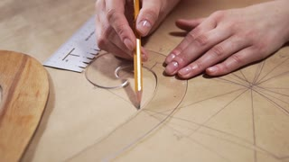 The engineer draws on a paper with a pencil, tailor makes pattern for seawing dresses, architect is making a drawing, mechanical drawing