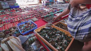 Woman chooses traditional jewelry on the local indian market