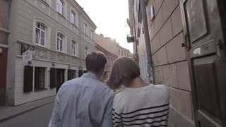 Young couple walking the street in old town