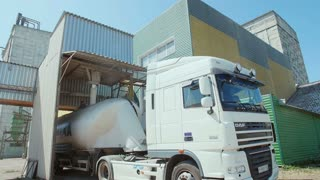 A truck loaded with flour in the factory on processing grain.
