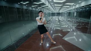 Business woman makes kung-fu exercise