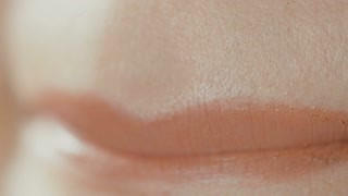 Fragment of female face, lips closeup