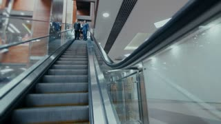 group of businessmen traveling on escalator