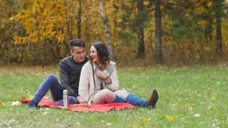 guy and girl having a picnic