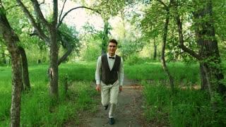 Happy boy running in the park.