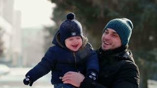 Happy family walking in the park in winter.