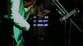 musician plays the guitar.