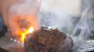Steak ignited fire close-up