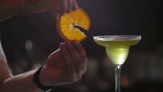 The bartender at the restaurant prepares a cocktail . Slow motion.