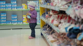 The little girl in shop