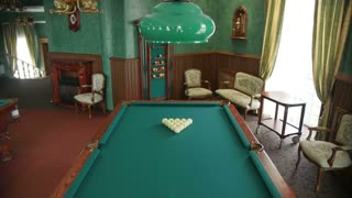 The room in which there is a pool table.