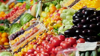 the seller arranges fruits on display