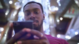 African American Man using business app on smart phone