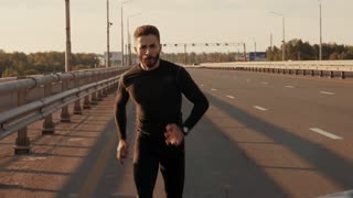 Athletic young man running in the nature. Healthy lifestyle.