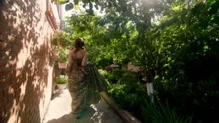 Beautiful woman in long dress poses.