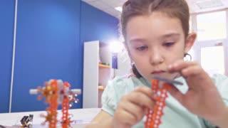 Children creating robots at school, stem education. Early development, diy, innovation, modern technology concept.