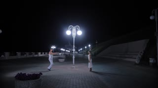 Couple of lovers dancing in empty night street, dating and love, seduction.