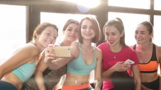 group of women communicate and make selfies