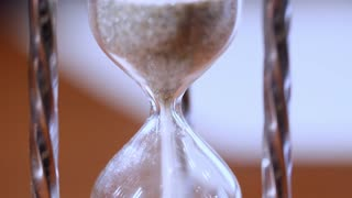 Hourglass as time passing concept for business deadline, urgency and running out of time.