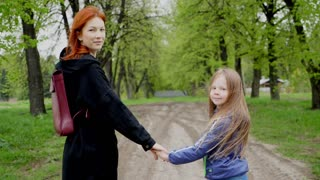 Mother and daughter in in the spring park.