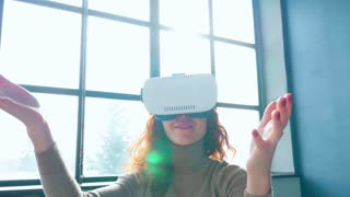 Redhead woman with virtual reality glasses