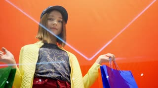 Sale and fashion concept. Kid with confident face expression and casual hairdo does shopping.