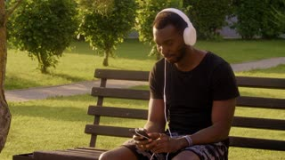 Slow Motion Portrait of mature african american man in city listening to music real people.