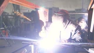 welder Industrial automotive part in factory.