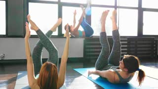 Women Stretching and Relaxing in Yoga Class