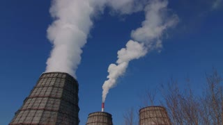 view of power heat station, smoke from the chimney on a frosty