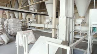 Working mechanisms in the factory on processing grain.