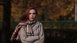 beautiful woman freezing in autumn park, cold autumn