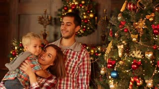 Happy Family Decorating Christmas and New Year Tree together. Father, Mother And Son. Cute Child. Kid 2017