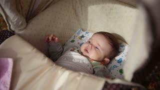Sweet little baby sleeping in stroller