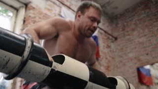 Athlete going to beat barbell snatch record at the gym with supporting team in slow motion.