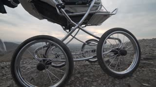 Baby stroller in the mountains, outdoors