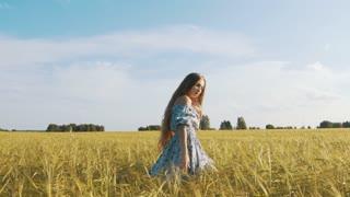 Beautiful Brunette Runs Through a Wheat Field