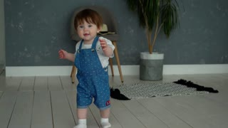 beautiful little baby learns to walk