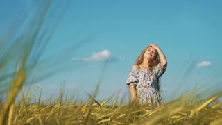 Beauty Girl with Healthy Long Hair Outdoors. Happy Smiling Young Woman falling down on the grass.