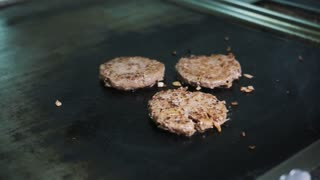 beef burger grilling professional flipping