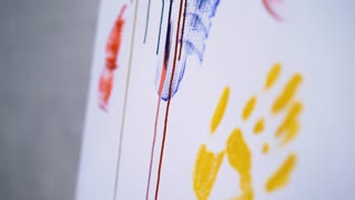 Close-up of painter doing a stroke