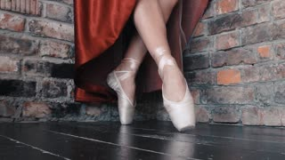 Closeup Of Ballerina's Feet, Warming Up Outside On The Sidewalk